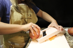 Here I am slicing the sweet potato. Always when using a mandolin slicer use with caution and extreme carefulness.