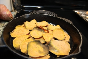 Begin placing those beautiful sweet potato chips in a cast iron skillet.